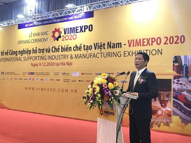 Bộ trưởng Bộ Công Thương Trần Tuấn Anh phát biểu tại Triển lãm quốc tế về công nghiệp hỗ trợ và chế biến, chế tạo sáng 9/12. (Ảnh: Đức Duy/Vietnam+)